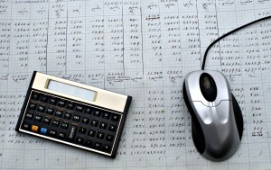 The old manual sheet, newer calculator and newset computer mouse